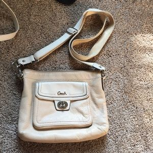 Coach cross body purse in tan